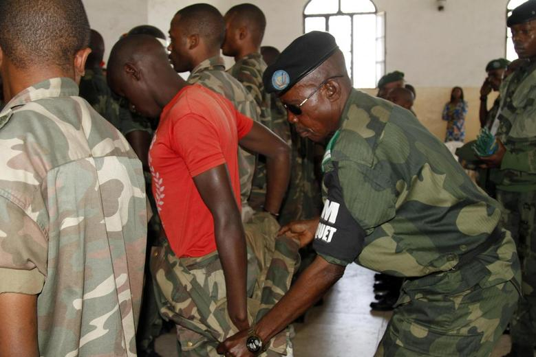 A Congolese soldier is stripped of his rank and uniform after the mass trial of 39 soldiers inside a military court in Goma in eastern Democratic Republic of Congo, May 5, 2014. REUTERS/Kenny Katombe