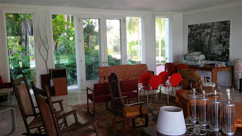 A living room overlooking gardens in a mansion once owned by Colombian drug lord Pablo Escobar in Miami Beach, is seen in this undated handout picture provided by One Sotheby's Realty. REUTERS/One Sotheby's Realty/Handout