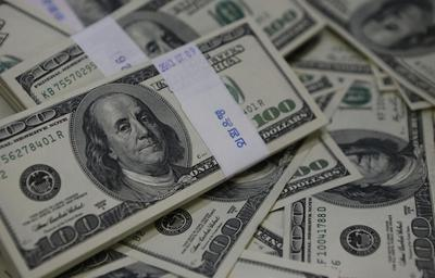 Euro holds line on dollar, drops against sterling