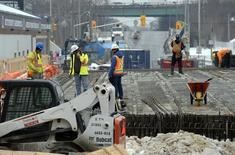 People work at a bridge under construction in Toronto February 20, 2014. Picture taken February 20. REUTERS/Aaron Harris