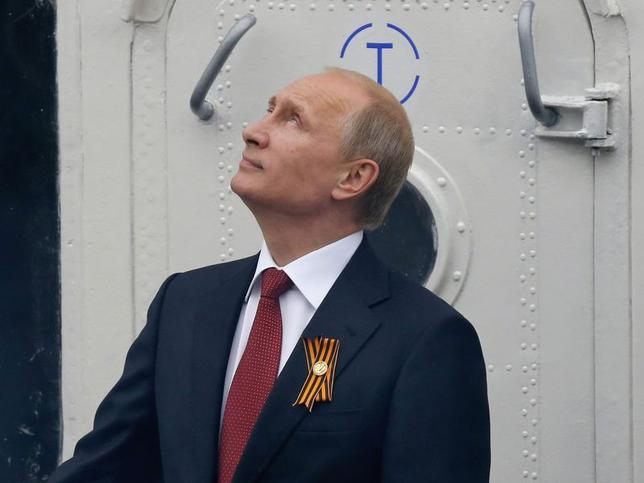 5月9日、ロシアのプーチン大統領は、クリミア編入以来初めて現地を訪れた。写真はセバストポリで同日撮影(2014年 ロイター/Maxim Shemetov)