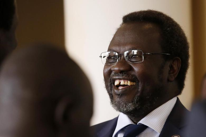 South Sudan's rebel leader Riek Machar smiles as he meets his friends at Sheraton Hotel in Addis Ababa May 9, 2014. REUTERS/Goran Tomasevic