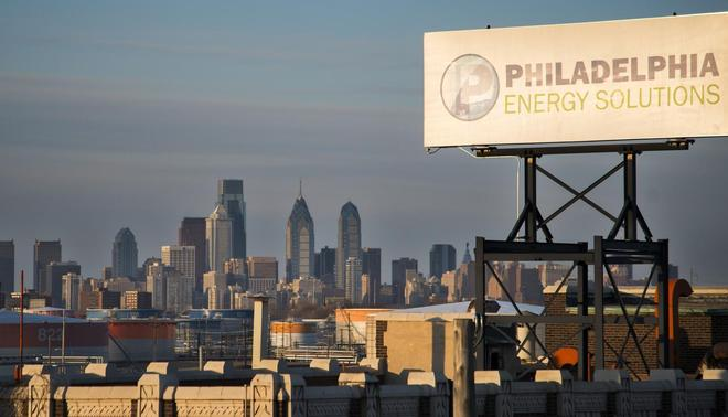 The Philadelphia Energy Solutions oil refinery owned by The Carlyle Group is seen at sunset in front of the Philadelphia skyline March 24, 2014. REUTERS-David M. Parrott