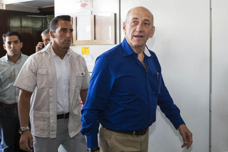 Former Israeli PM Olmert sentenced to six years for...
