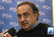 Fiat Chrysler CEO Sergio Marchionne talks to the media during the FCA Investors Day at the Chrysler World Headquarters in Auburn Hills, Michigan May 6, 2014. REUTERS/Rebecca Cook