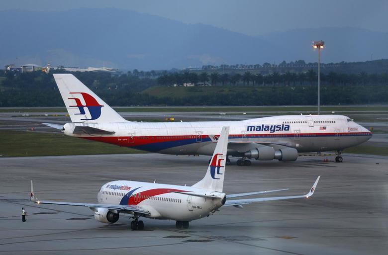 Malaysia Airlines aircrafts taxi on the runway at Kuala Lumpur International Airport in Sepang outside Kuala Lumpur May 13, 2014. REUTERS/Samsul Said