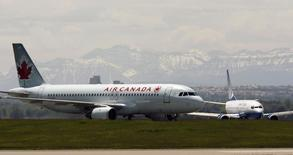An Air Canada plane lands in front of a United plane at the Calgary International Airport in Calgary, Alberta, June 17, 2008. REUTERS/Todd Korol