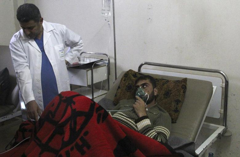 A man, affected by what activists say was a gas attack, breathes through an oxygen mask inside a field hospital in Kfar Zeita village in the central province of Hama April 12, 2014. REUTERS/Stringer