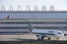 An Alitalia plane is parked on the tarmac at Fiumicino international airport in Rome December 10, 2013. REUTERS/Max Rossi