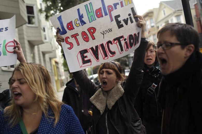 Demonstrators shout during a rally in the Mission neighborhood in San Francisco, California April 11, 2014. REUTERS/Robert Galbraith