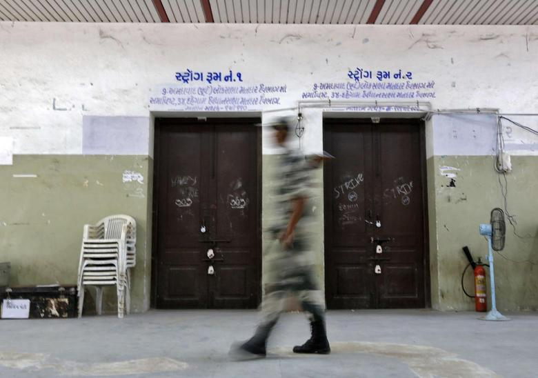 A security personnel stands guard outside a sealed strong room where electronic voting machines (EVM) are kept, in the western Indian city of Ahmedabad May 15, 2014. REUTERS/Amit Dave