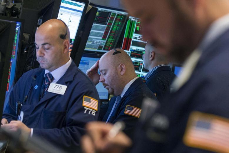 Traders work on the floor of the New York Stock Exchange May 16, 2014. REUTERS/Brendan McDermid
