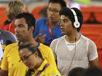 Colombia's track cyclist Edwin Alcibiades Avila Vanegas uses a pair of Beats by Dr. Dre headphones at the Velodrome during the London 2012 Olympic Games August 3, 2012. REUTERS/Stefano Rellandini