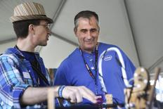 Intel CEO Brian Krzanich (R) listens to Node.js Sandbox creator Michael McCool (L) at the Maker's Faire in San Mateo, California May 17, 2014. REUTERS/Elijah Nouvelage