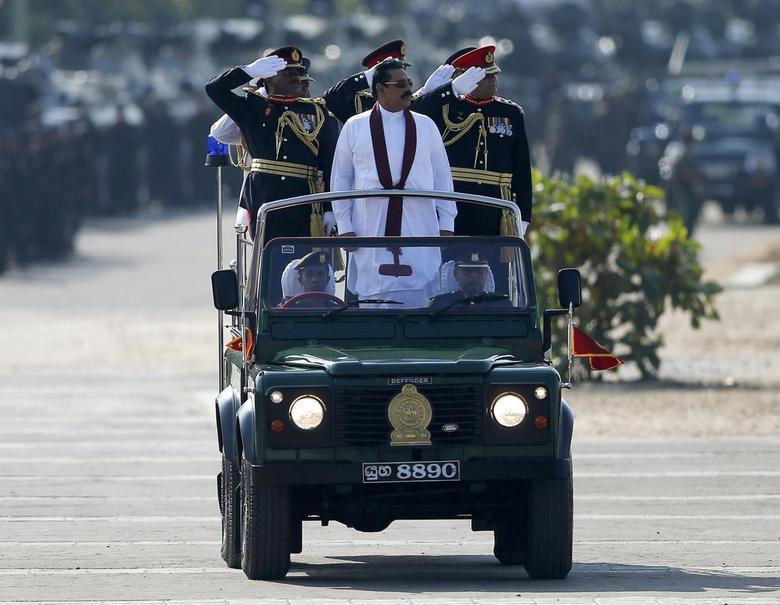 Sri Lanka's President Mahinda Rajapaksa (in white) takes part in a War Victory parade in Matara May 18, 2014. REUTERS/Dinuka Liyanawatte