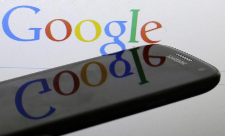 A Google logo is reflected on the screen of a Samsung Galaxy S4 smartphone in this photo illustration taken in Prague January 31, 2014. REUTERS/David W Cerny