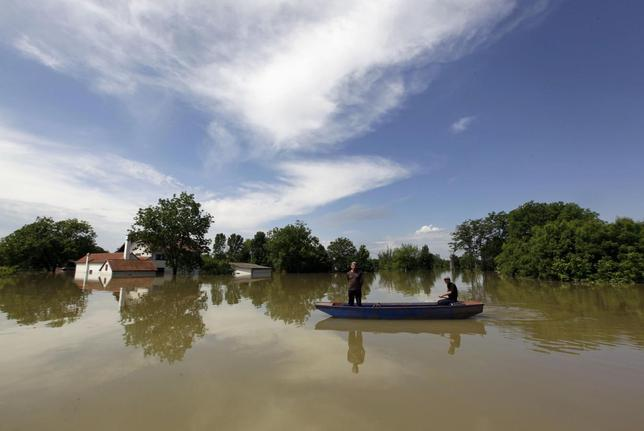 Villagers paddle during heavy floods in the village of Prud, May 20, 2014. REUTERS/Srdjan Zivulovic