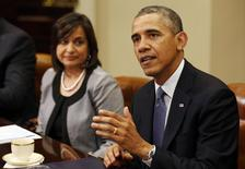 U.S. President Barack Obama talks to international business leaders at a meeting in the Roosevelt Room of the White House in Washington May 20, 2014. Also pictured is President of Umicore USA, Ravila Gupta (L). REUTERS/Larry Downing