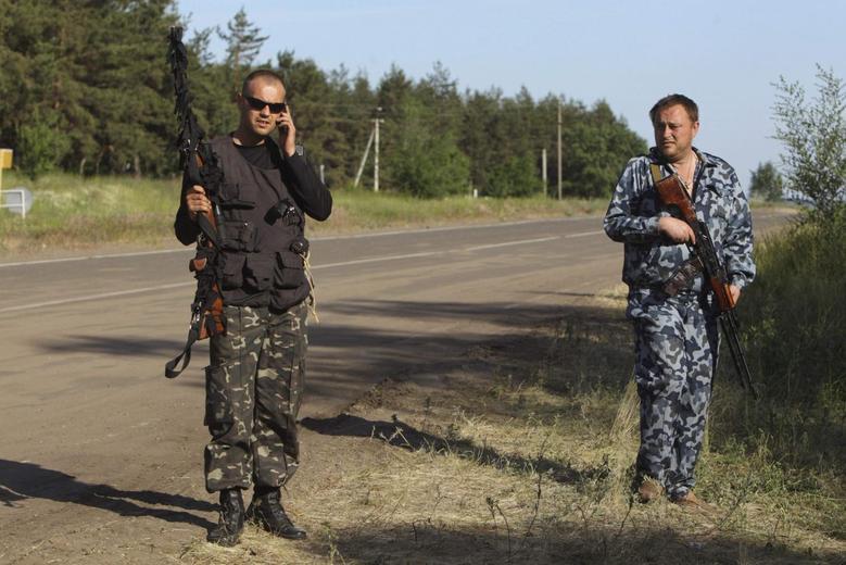Ukraine forces, pro-Russian rebels clash as election...