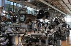 A workers walks in the factory inside the Glaeserne Manufaktur (transparent factory) where Germany's car maker Volkswagen AG assemble the luxury model Phaeton, in Dresden May 14, 2013. REUTERS/Fabrizio Bensch