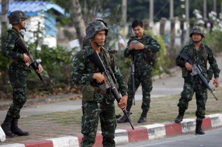 Thai army chief summons ousted PM for talks a day...