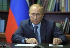 Russian President Vladimir Putin attends a meeting with top officials in Blagoveshchensk May 22, 2014. REUTERS/Alexei Druzhinin/RIA Novosti/Kremlin