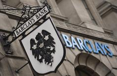 Logos are seen outside a branch of Barclays bank in London July 30, 2013. REUTERS/Toby Melville