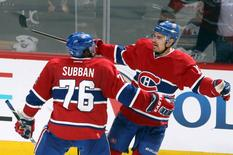 May 27, 2014; Montreal, Quebec, CAN; Montreal Canadiens left wing Rene Bourque (17) celebrates his goal against New York Rangers with teammate defenseman P.K. Subban (76) during the third period in the game five of the Eastern Conference Finals of the 2014 Stanley Cup Playoffs at Bell Centre. Mandatory Credit: Jean-Yves Ahern-USA TODAY Sports