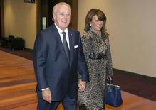 Former Canadian Prime Minister Brian Mulroney arrives with his wife Mila at the Barrick Gold annual general meeting for shareholders in Toronto, April 30, 2014. REUTERS/Mark Blinch