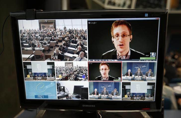 Accused government whistleblower Edward Snowden is seen on a screen as he speaks via video conference with members of the Committee on legal Affairs and Human Rights of the Parliamentary Assembly of the Council of Europe during a hearing on ''mass surveillance'' at the Council of Europe in Strasbourg, April 8, 2014. REUTERS/Vincent Kessler/Files
