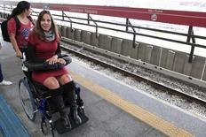 Congresswoman Mara Gabrilli, a quadriplegic and an international activist on disability issues, waits for a train to Arena de Sao Paulo stadium at a subway station in Sao Paulo June 1, 2014. REUTERS/Chico Ferreira