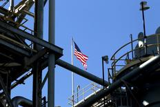 A U.S. flag is seen at full mast atop the methylene diphenyl diisocyanate (MDI) 3 unit at Huntsman's polyurethane plant in Geismar, Louisiana May 5, 2014. Picture taken May 5, 2014. To match Special Report USA-GERMANY/POWER REUTERS/Jonathan Bachman (UNITED STATES - Tags: ENERGY BUSINESS INDUSTRIAL POLITICS)