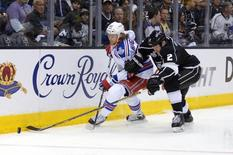Jun 4, 2014; Los Angeles, CA, USA; New York Rangers left wing Carl Hagelin (62) battles for the puck against Los Angeles Kings defenseman Matt Greene (2) in the second period during game one of the 2014 Stanley Cup Final at Staples Center. REUTERS/Kirby Lee via USA TODAY Sports