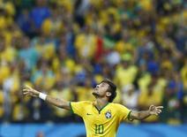 Atacante brasileiro Neymar celebra gol durante partida de abertura da Copa do Mundo entre Brasil e Croácia, em São Paulo. 12/6/2014 REUTERS/Murad Sezer