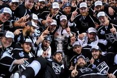 Jun 13, 2014; Los Angeles, CA, USA; Los Angeles Kings players pose for a team photo with the Stanley Cup after defeating the New York Rangers game five of the 2014 Stanley Cup Final at Staples Center. Mandatory Credit: Gary A. Vasquez-USA TODAY Sports