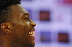 England's Daniel Sturridge laughs during a news conference after a training session at the 2014 World Cup in Rio de Janeiro June 16, 2014. REUTERS/Ricardo Moraes