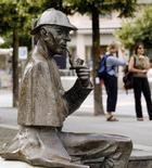 A life-size bronze figure of British author Arthur Conan Doyle's character, the detective Sherlock Holmes created by artist John Doubleday 1988 is pictured on the main square in the town of Meiringen, some 100 km (62 miles) south east of the Swiss capital Bern July 6, 2010. REUTERS/Arnd Wiegmann