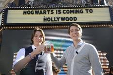 "Actors James (L) and Oliver Phelps toast with ""butterbeer"" following an announcement of the new ""The Wizarding World of Harry Potter"" attraction to be built at Universal Studios Hollywood in Los Angeles December 6, 2011. REUTERS/Phil McCarten"