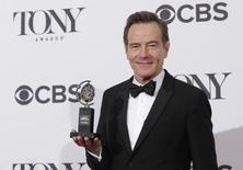 """Actor Bryan Cranston poses backstage with his Tony Award for best performance by an actor in a leading role in a play for """"All the Way"""" at the American Theatre Wing's 68th annual Tony Awards at Radio City Music Hall in New York, June 8, 2014. REUTERS/Andrew Kelly"""