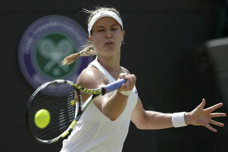 Eugenie Bouchard of Canada hits a return during her women's singles quarter-final tennis match against Angelique Kerber of Germany at the Wimbledon Tennis Championships, in London July 2, 2014.  REUTERS/Max Rossi