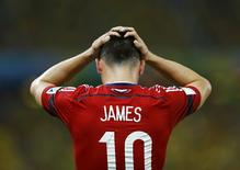 Colombia's James Rodriguez reacts after missing a goal scoring opportunity against Brazil during their 2014 World Cup quarter-finals at the Castelao arena in Fortaleza July 4, 2014. REUTERS/Marcelo Del Pozo