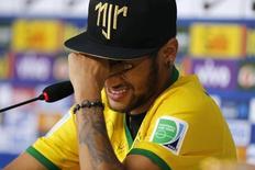 Injured Brazilian national soccer team player Neymar cries during a news conference in Teresopolis, near Rio de Janeiro, July 10, 2014.  REUTERS/Marcelo Regua