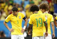 Brazil's Thiago Silva (L), Willian and David Luiz react after the 2014 World Cup third-place playoff between Brazil and the Netherlands at the Brasilia national stadium in Brasilia July 12, 2014. REUTERS/Ueslei Marcelino (BRAZIL  - Tags: SOCCER SPORT WORLD CUP)