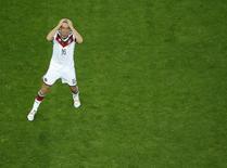 Игрок сборной Германии Филипп Лам в матче чемпионата мира против Алжира в Порту-Алегри 30 июня 2014 года. Капитан сборной Германии Филипп Лам объявил в пятницу, спустя всего несколько дней после победы в составе сборной на мировом первенстве в Бразилии, о завершении международной карьеры. REUTERS/Fabrizio Bensch