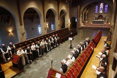 Trappist Monks pray during a midday service at Saint Joseph's Abbey in Spencer, Massachusetts July 22, 2014.   REUTERS/Brian Snyder