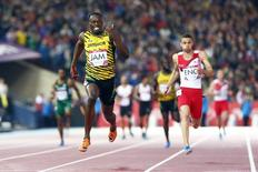 Jamaica's Usain Bolt runs the anchor leg as Jamaica wins the men's 4x100m relay final at the 2014 Commonwealth Games in Glasgow, Scotland, August 2, 2014.               REUTERS/Andrew Winning