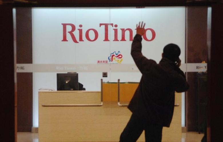 A man waits to enter the Rio Tinto Limited Shanghai Representative Office in Shanghai March 18, 2010.   REUTERS/Stringer