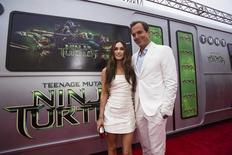 "Cast members Megan Fox and Will Arnett pose at the premiere of ""Teenage Mutant Ninja Turtles"" in Los Angeles, California August 3, 2014. REUTERS/Mario Anzuoni"