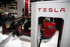 A Tesla model S car with an electric vehicle charging station is displayed during a media preview day at the Frankfurt Motor Show (IAA) September 10, 2013.  REUTERS/Kai Pfaffenbach