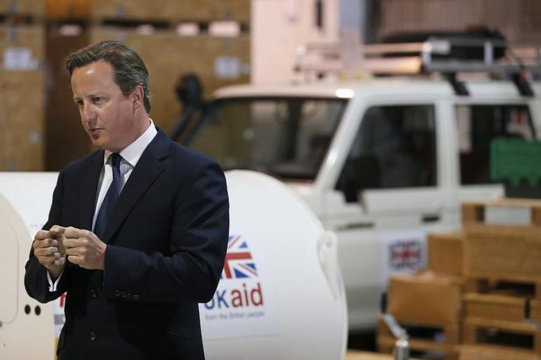 Britain's Prime Minister David Cameron speaks during a visit to a UK aid Disaster Response Centre at Kemble Airport, southern England August 14, 2014.  REUTERS/Stefan Wermuth